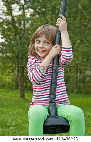 little girl playing on a outdoor playground - stock photo