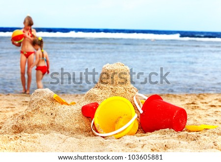 Little girl  playing on  beach with ball. - stock photo