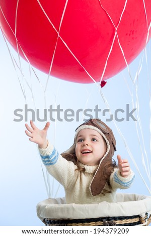 little girl playing on hot air balloon in the sky - stock photo