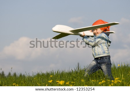 Little girl playing on spring meadow - stock photo