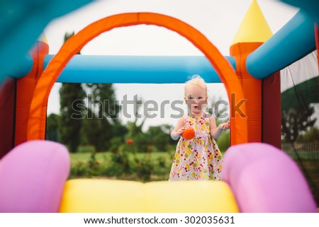 Little girl playing on trampoline - stock photo