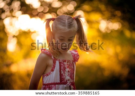 Little girl playing outside - stock photo
