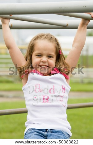 Little Girl Playing Outside With Big Smile - stock photo