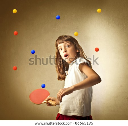 Little girl playing ping pong with many balls