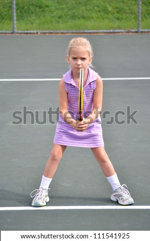 little girl playing tennis - stock photo