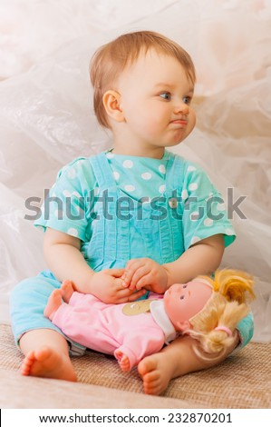 little girl playing with a dolland funny ape - stock photo