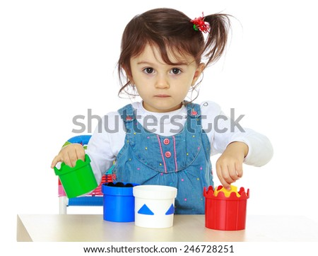 Little girl playing with a table.concept childhood education and child development.Isolated on white background - stock photo