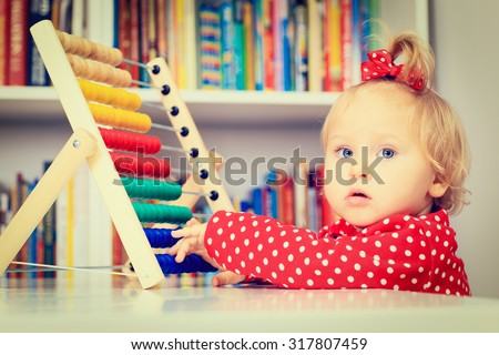 little girl playing with abacus, early learning concept - stock photo