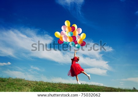 Little girl playing with balloons - stock photo