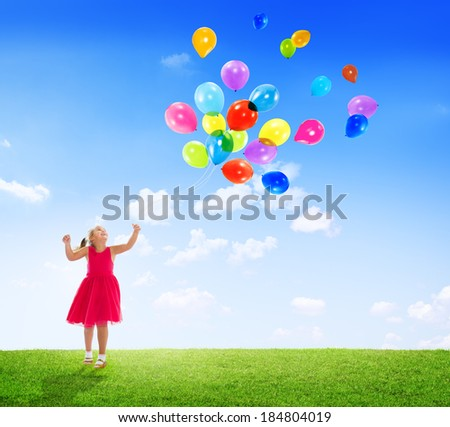 Little Girl Playing with Balloons Outdoors - stock photo