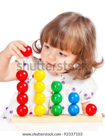 little girl playing with balls - stock photo