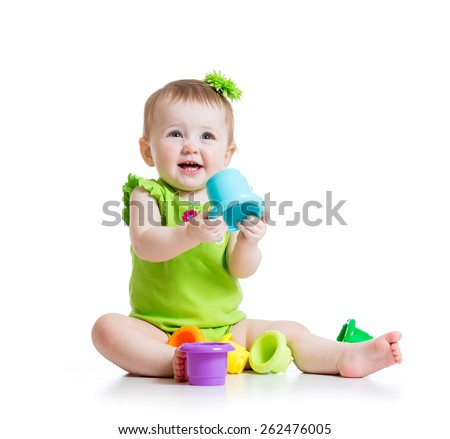 little girl playing with color toys isolated on white - stock photo