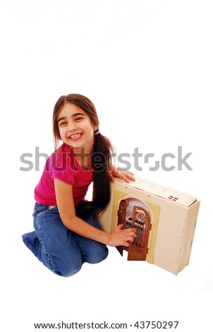 Little girl playing with dolls house isolated on white