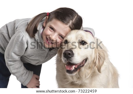 Little girl playing with her dog golden retriever - stock photo