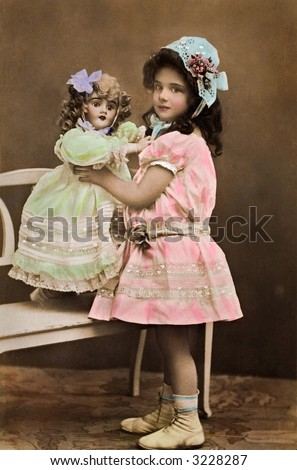 Little girl playing with her doll - a 1909 vintage hand-tinted photo