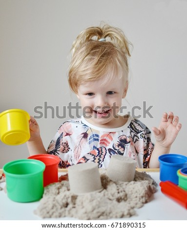 Little Girl Playing with Kinetic Sand at Home Early Education Preparing for School  Development