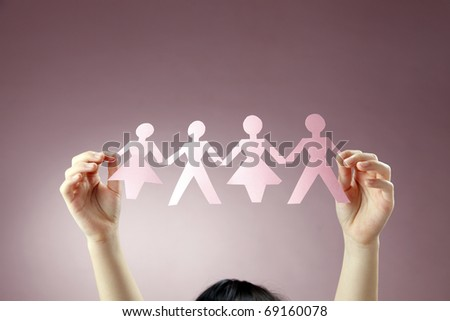 little girl playing with paper chain - stock photo