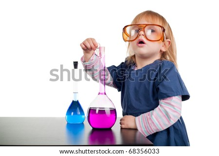 little girl playing with test tubes