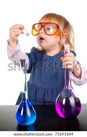 little girl playing with test tubes - stock photo