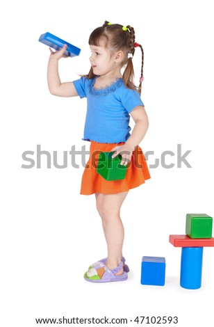 Little girl playing with toys isolated on white background - stock photo