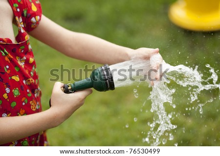 Little girl playing with water