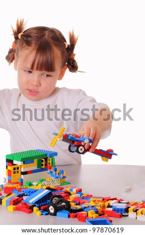 Little girl plays a game with a toy airplane - stock photo