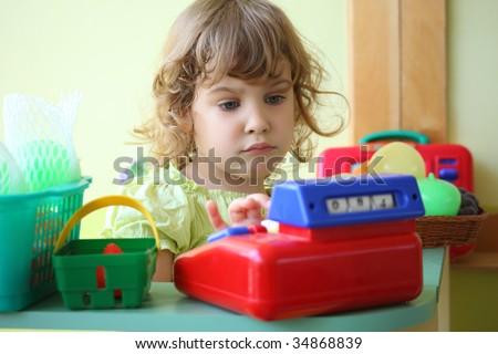 little girl plays shop - stock photo