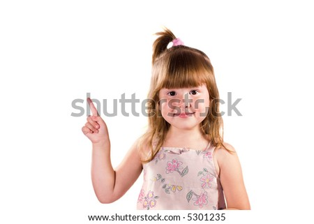 Little girl pointig up looking at you with smile isolated on white - stock photo