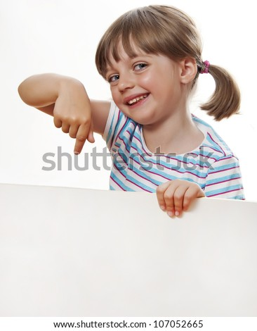 little girl pointing white blank with copy space - stock photo