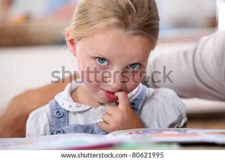 little girl pondering - stock photo