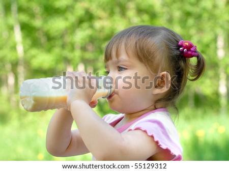 Little girl portrait drinking milk beverage - stock photo
