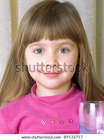 little girl portrait drinking water. - stock photo