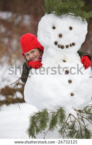 Little girl portrait, happy posing with snowman