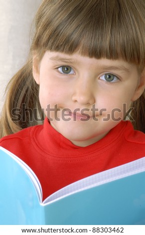 Little girl portrait reading a book. - stock photo