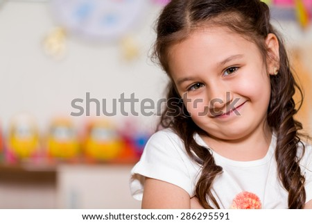 Little girl posing at camera. - stock photo