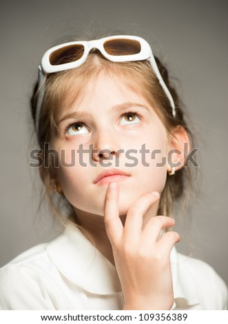 Little girl posing for her first model portfolio - stock photo