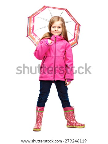 Little girl posing in fashion style wearing autumn clothing. Rubber boots. - stock photo