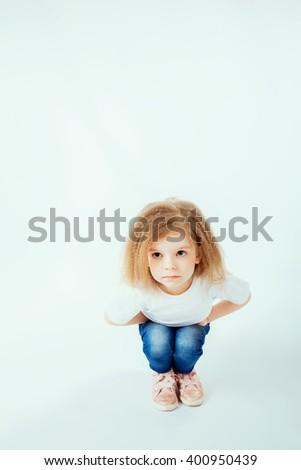Little girl posing isolated on white - stock photo
