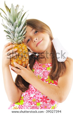 Little girl posing with big pineapple - stock photo