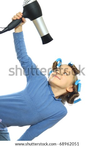 little girl posing with hair dryer - stock photo
