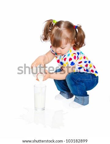 little girl pours milk - stock photo