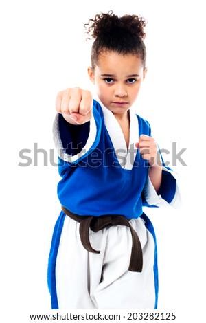 Little girl practice karate isolated on white - stock photo