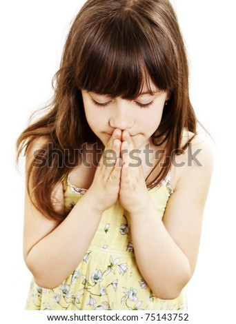 Little girl praying - closeup - stock photo