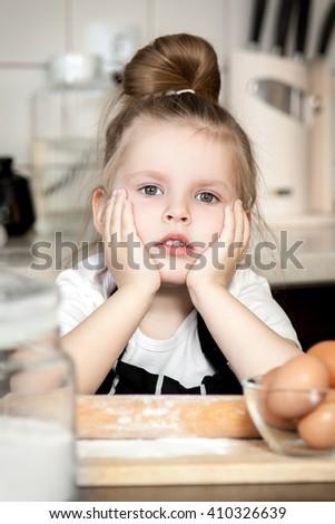 little girl preparing dough - stock photo