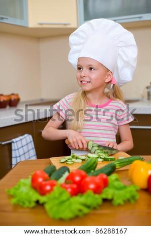Little girl preparing healthy food on kitchen - stock photo