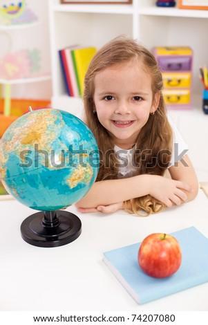Little girl preparing to go to school - stock photo