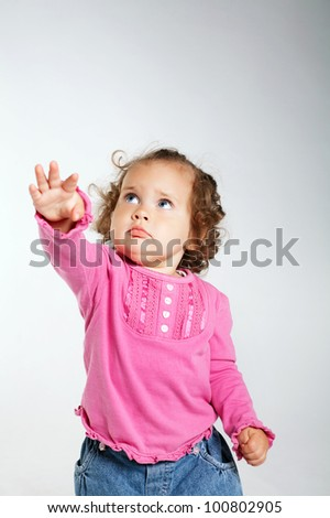 little girl pulling hand up - stock photo