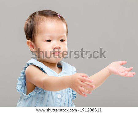 Little girl pulling hand up