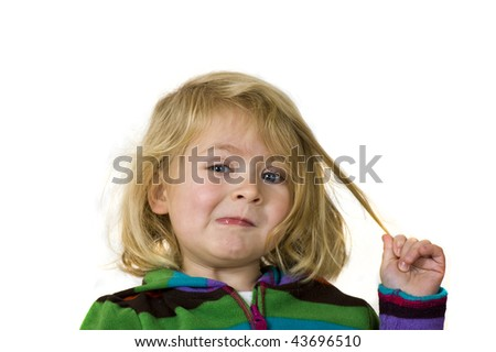 Little Girl Pulling on Her Hair and making a Funny Face - stock photo