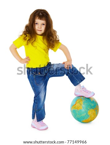 Little girl put her foot on geographic globe - stock photo